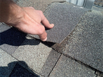 Roof inspection on roofing ridge