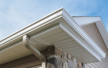 Gutter coil with soffit panels