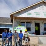 Habitat crew by house