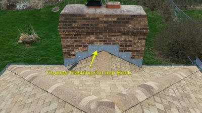 Step flashing on chimney