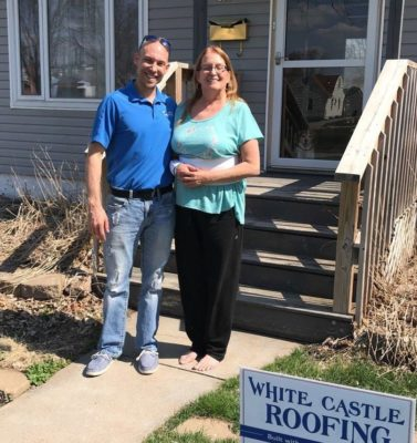 White Castle Roofing specialist with customer