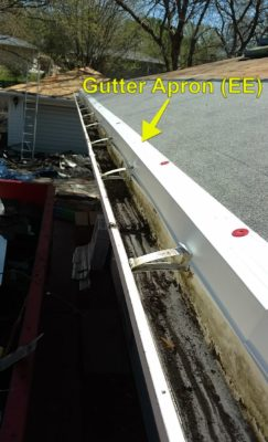 Gutter apron on a roof