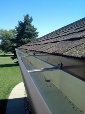 Seamless gutters on house's roof